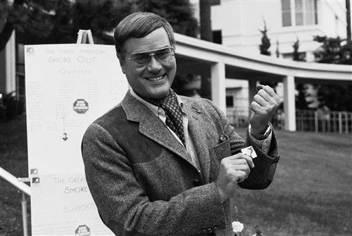 Actor Larry Hagman pulls on his elastic wrist band during activites marking the Great American Smokeout at St.John&#39;s Hospital in Santa Monica, Calif. on Thursday, Nov. 18, 1982.   Smokers participating in the smokeout were urged to pull on their elastic whenever they felt the urge to smoke. &#40;AP Photo&#47;Wally Fong&#41; <span class=meta>(AP Photo&#47; Wally Fong)</span>