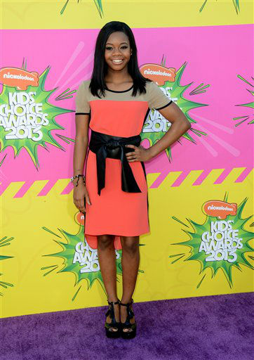 "<div class=""meta image-caption""><div class=""origin-logo origin-image ""><span></span></div><span class=""caption-text"">Olympic gymnast Gabby Douglas arrives at the 26th annual Nickelodeon's Kids' Choice Awards on Saturday, March 23, 2013, in Los Angeles. (Photo by Jordan Strauss/Invision/AP) (Photo/Jordan Strauss)</span></div>"