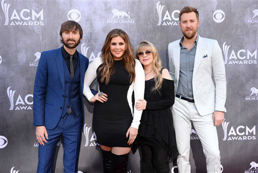 Stevie Nicks, second from right, and from left, Dave Haywood, Hillary Scott and Charles Kelley, of the musical group Lady Antebellum, arrive at the 49th annual Academy of Country Music Awards at the MGM Grand Garden Arena on Sunday, April 6, 2014, in Las Vegas. &#40;Photo by Al Powers&#47;Powers Imagery&#47;Invision&#47;AP&#41; <span class=meta>(Al Powers&#47;Powers Imagery)</span>