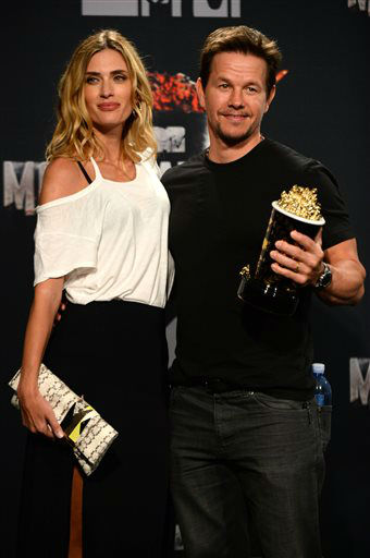 Mark Wahlberg, right, poses in the press room with his MTV Generation Award, and Rhea Durham, at the MTV Movie Awards on Sunday, April 13, 2014, at Nokia Theatre in Los Angeles. &#40;Photo by Jordan Strauss&#47;Invision&#47;AP&#41; <span class=meta>(Photo&#47;Jordan Strauss)</span>