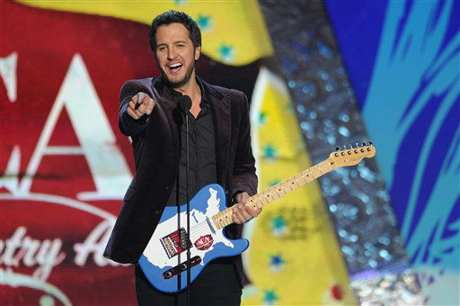 Luke Bryan accepts the award for &#39;Artist of the Year&#39; during the American Country Awards on Monday, Dec. 10, 2012, in Las Vegas. &#40;Photo by Al Powers&#47;Powers Imagery&#47;Invision&#47;AP&#41; <span class=meta>(Photo&#47;Al Powers)</span>