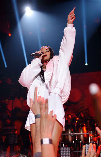 "<div class=""meta image-caption""><div class=""origin-logo origin-image ""><span></span></div><span class=""caption-text"">Rihanna performs on stage at the MTV Movie Awards, on Sunday, April 13, 2014, in Los Angeles.  (Photo by John Shearer/Invision for MTV/AP Images)</span></div>"