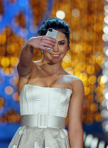"<div class=""meta ""><span class=""caption-text "">Miss America judge McKayla Maroney photographs herself onstage before the pageant on Saturday, Jan. 12, 2013, in Las Vegas. (AP Photo/Isaac Brekken) (AP Photo/ Isaac Brekken)</span></div>"