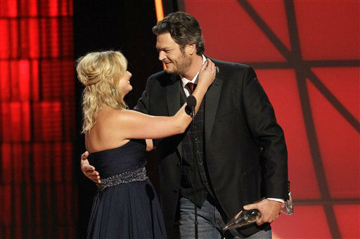 "<div class=""meta ""><span class=""caption-text "">Miranda Lambert, left, and Blake Shelton embrace onstage after winning the award for song of the year for ""Over You"" at the 46th Annual Country Music Awards at the Bridgestone Arena on Thursday, Nov. 1, 2012, in Nashville, Tenn. (Photo by Wade Payne/Invision/AP) (Photo/Wade Payne)</span></div>"