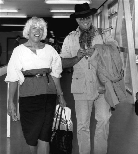 Actor Larry Hagman, who plays JR Ewing in the television series  &#39;Dallas&#39;, arrives at London&#39;s Heathrow Airport on Tuesday, Sept. 3, 1985 from Los Angeles with his wife Maj.   <span class=meta>(AP Photo&#47; anonymous)</span>