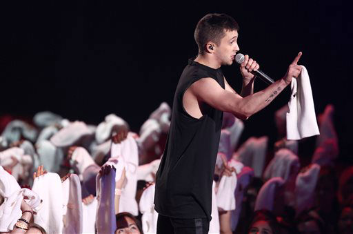 Tyler Joseph of Twenty One Pilots performs on stage at the MTV Movie Awards on Sunday, April 13, 2014, at Nokia Theatre in Los Angeles. &#40;Photo by Matt Sayles&#47;Invision&#47;AP&#41; <span class=meta>(Photo&#47;Matt Sayles)</span>
