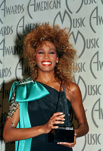 "<div class=""meta image-caption""><div class=""origin-logo origin-image ""><span></span></div><span class=""caption-text"">Singer Whitney Houston shows her American Music Award, at the Shrine Auditorium in Los Angeles, Calif., Jan. 27, 1986.  (AP Photo) (AP Photo/ Anonymous)</span></div>"