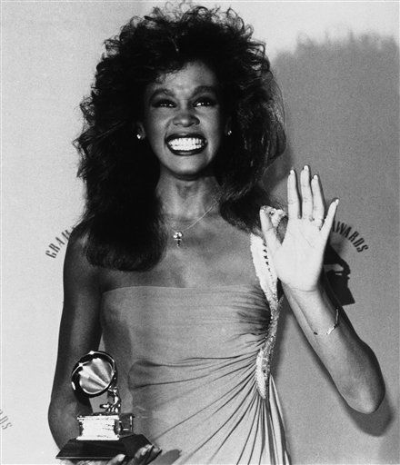 Singer Whitney Houston accepts her Grammy Award on Tuesday, Feb. 25, 1986 in Los Angeles for pop female vocal performance with ?Saving All My Love For You.? Miss Houston was snubbed for the award as best new artist. &#40;AP Photo&#41; <span class=meta>(AP Photo&#47; Anonymous)</span>