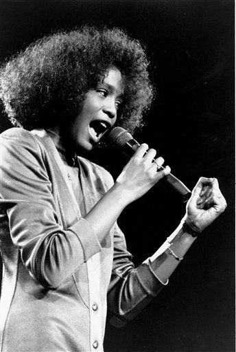 In this May 10, 1986, file photo, American singer Whitney Houston belts out a song during her segment of a benefit concert at Boston Garden. Houston died Saturday, Feb. 11, 2012, she was 48. &#40;AP Photo&#47;Elise Amendola&#41; <span class=meta>(AP Photo&#47; ELISE AMENDOLA)</span>