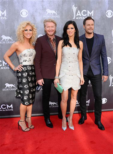 Kimberly Schlapman, and from left, Philip Sweet, Karen Fairchild and Jimi Westbrook, of the musical group Little Big Town, arrive at the 49th annual Academy of Country Music Awards at the MGM Grand Garden Arena on Sunday, April 6, 2014, in Las Vegas. &#40;Photo by Al Powers&#47;Powers Imagery&#47;Invision&#47;AP&#41; <span class=meta>(Al Powers&#47;Powers Imagery)</span>