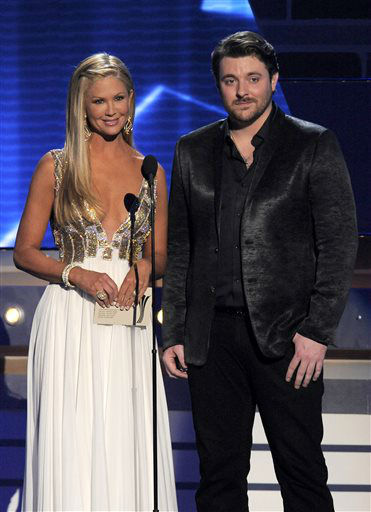 "<div class=""meta image-caption""><div class=""origin-logo origin-image ""><span></span></div><span class=""caption-text"">TV personality Nancy O'Dell, left, and singer Chris Young present the award for single record of the year at the 48th Annual Academy of Country Music Awards at the MGM Grand Garden Arena in Las Vegas on Sunday, April 7, 2013. (AP photo)</span></div>"