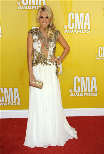 "<div class=""meta image-caption""><div class=""origin-logo origin-image ""><span></span></div><span class=""caption-text"">Carrie Underwood arrives at the 46th Annual Country Music Awards at the Bridgestone Arena on Thursday, Nov. 1, 2012, in Nashville, Tenn.   (Photo/Chris Pizzello)</span></div>"