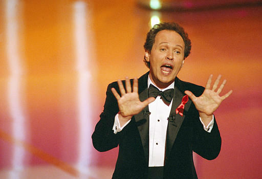 Billy Crystal, host of the 64th Annual Academy Awards, sings on stage Monday, March 30, 1992  in Los Angeles. &#40;AP Photo&#47;Craig Fujii&#41; <span class=meta>(AP Photo&#47; Craig Fujii)</span>