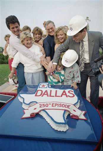 Members of the cast of the television series   &#39;Dallas&#39; gather to cut a cake celebrating the 250th episode during a party at South fork Ranch in Parker, Texas on Friday, May 8, 1987. From left, standing, are:Patick Duffy, Barbara Bel Geddes, Linda Gray, Larry Hagman, Shree J. Wilson and David Salzman, president of Lorimar Television. The children are: Omri Katz and Joshua Harries.  <span class=meta>(AP Photo&#47; Steve Krauss)</span>