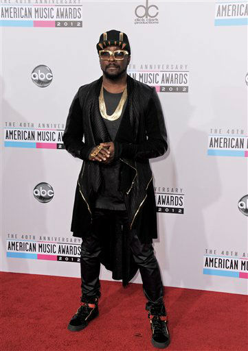 will.i.am arrives at the 40th Anniversary American Music Awards on Sunday, Nov. 18, 2012, in Los Angeles. (Photo by Jordan Strauss/Invision/AP)