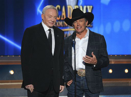 Jerry Jones, left, and George Strait speak on stage at the 49th annual Academy of Country Music Awards at the MGM Grand Garden Arena on Sunday, April 6, 2014, in Las Vegas. &#40;Photo by Chris Pizzello&#47;Invision&#47;AP&#41; <span class=meta>(Photo&#47;Chris Pizzello)</span>