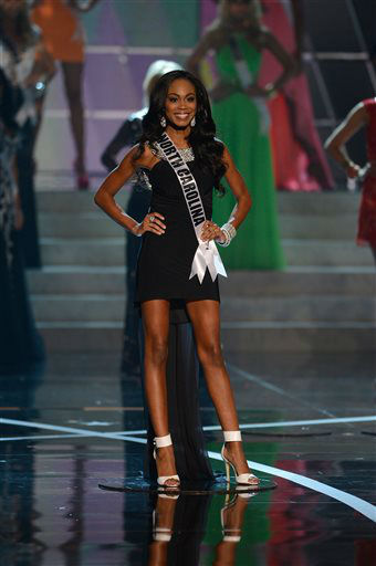 Miss North Carolina Ashley Mills, from Raleigh, N.C,, walks the runway during the introductions of the Miss USA 2013 pageant, Sunday, June 16, 2013, in Las Vegas.  <span class=meta>(AP Photo&#47; Jeff Bottari)</span>