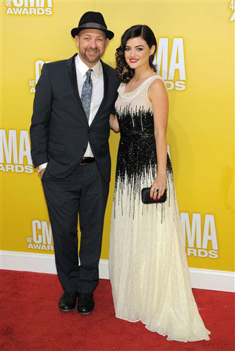"<div class=""meta ""><span class=""caption-text "">Kristian Bush, left, and Lucy Hale arrive at the 46th Annual Country Music Awards at the Bridgestone Arena on Thursday, Nov. 1, 2012, in Nashville, Tenn.  (Photo/Chris Pizzello)</span></div>"