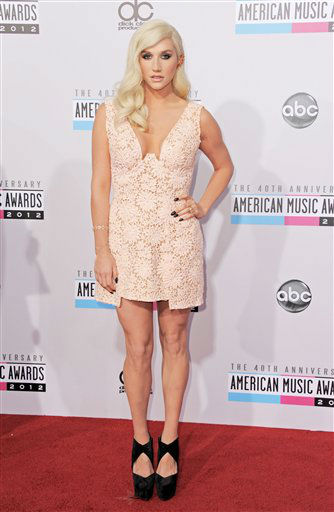 Kesha arrives at the 40th Anniversary American Music Awards on Sunday, Nov. 18, 2012, in Los Angeles.