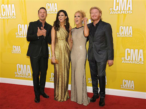 "<div class=""meta ""><span class=""caption-text "">Musical group Little Big Town, from left, Jimi Westbrook, Karen Fairchild, Kimberly Schlapman and Phillip Sweet, arrive at the 46th Annual Country Music Awards at the Bridgestone Arena on Thursday, Nov. 1, 2012, in Nashville, Tenn.   (Photo/Chris Pizzello)</span></div>"