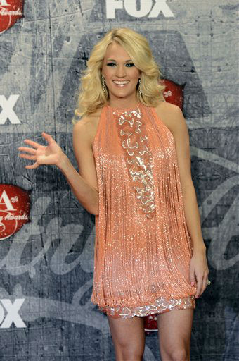 "<div class=""meta ""><span class=""caption-text "">Singer Carrie Underwood poses in the press room with her awards for Female Artist of the Year and Single by a Vocal Collaboration backstage at the American Country Awards on Monday, Dec. 10, 2012, in Las Vegas. (Photo by Jeff Bottari/Invision/AP) (Photo/Jeff Bottari)</span></div>"