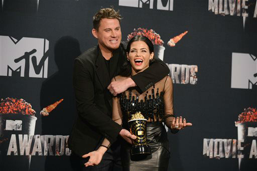 From left, Channing Tatum, winner of the Trailblazer Award poses with Jenna Dewan-Tatum in the press room at the MTV Movie Awards on Sunday, April 13, 2014, at Nokia Theatre in Los Angeles. &#40;Photo by Jordan Strauss&#47;Invision&#47;AP&#41; <span class=meta>(Photo&#47;Jordan Strauss)</span>