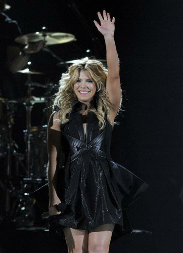 Kimberly Perry, of musical group The Band Perry, performs at the 48th Annual Academy of Country Music Awards at the MGM Grand Garden Arena in Las Vegas on Sunday, April 7, 2013. <span class=meta>(AP photo)</span>