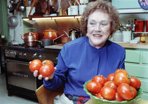 "<div class=""meta image-caption""><div class=""origin-logo origin-image ""><span></span></div><span class=""caption-text"">FILE- This Aug. 13, 1992 file photo shows chef and author Julia Child showing off tomatoes in the kitchen at her home in Cambridge, Mass. More so than the tools and techniques she popularized, Child's most lasting legacy may be her spirit and sense of humor. That was the conclusion of several chefs and food magazine editors asked to describe Child's memorable contributions to American home cooking as a new movie about her life is about to open. (AP Photo/Jon Chase,File) (AP Photo/ JON CHASE)</span></div>"