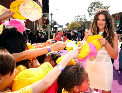 "<div class=""meta image-caption""><div class=""origin-logo origin-image ""><span></span></div><span class=""caption-text"">Khloe Kardashian arrives at the 26th annual Nickelodeon's Kids' Choice Awards on Saturday, March 23, 2013, in Los Angeles. (Photo by Todd Williamson/Invision/AP) (Photo/Todd Williamson)</span></div>"