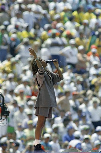 FILE - In this July 17, 1994, file photo, Whitney Houston performs before a sellout crowd at the Rose Bowl in Pasadena, Calif., during closing ceremonies for the final match that pits Italy against Brazil in the World Cup. Publicist Kristen Foster said, Saturday, Feb. 11, 2012, that singer Whitney Houston has died at age 48.   &#40;AP Photo&#47;Denis Paquin, File&#41; <span class=meta>(AP Photo&#47; Denis Paquin)</span>