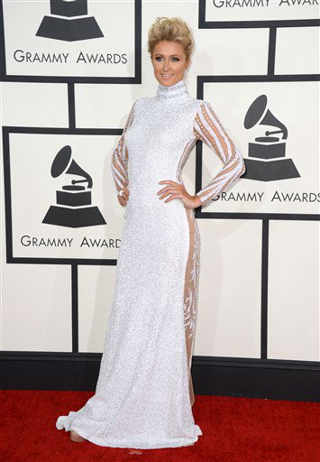 "<div class=""meta image-caption""><div class=""origin-logo origin-image ""><span></span></div><span class=""caption-text"">Paris Hilton arrives at the 56th annual GRAMMY Awards at Staples Center on Sunday, Jan. 26, 2014, in Los Angeles.   (Photo by Jordan Strauss/Invision/AP)</span></div>"