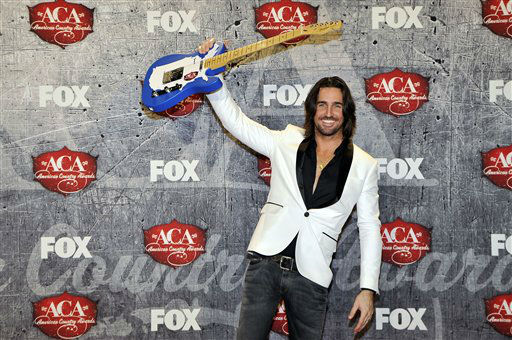 Recording artist Jake Owen poses in the press room with his award for Breakthrough Artist of the Year backstage at the American Country Awards on Monday, Dec. 10, 2012, in Las Vegas. &#40;Photo by Jeff Bottari&#47;Invision&#47;AP&#41; <span class=meta>(Photo&#47;Jeff Bottari)</span>