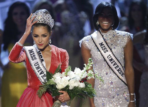 "<div class=""meta image-caption""><div class=""origin-logo origin-image ""><span></span></div><span class=""caption-text"">Miss USA, Olivia Culpo, left, adjusts her tiara after being crowned the new Miss Universe as Miss Universe 2011, Leila Lopes, of Angola, right, looks on, during the Miss Universe competition, Wednesday, Dec. 19, 2012, in Las Vegas.   (AP Photo/ Julie Jacobson)</span></div>"