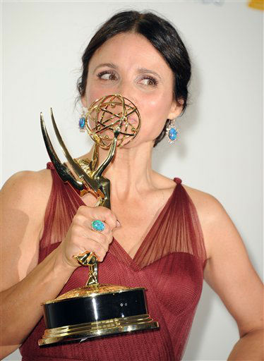 "<div class=""meta ""><span class=""caption-text "">Julia Louis Dreyfus poses for a photo at The 64th Annual Primetime Emmy Awards Winners Walk, Sunday, September 23, 2012, at LA Live, in Los Angeles.64th Primetime Emmy® Awards air live coast-to-coast on Sunday, September 23rd on ABC from the Nokia Theatre L.A. LIVE in Los Angeles.</span></div>"