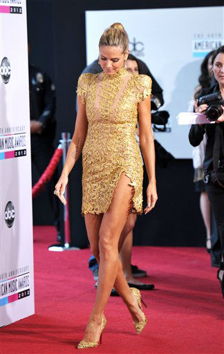 "<div class=""meta ""><span class=""caption-text "">Heidi Klum arrives at the 40th Anniversary American Music Awards on Sunday, Nov. 18, 2012, in Los Angeles. (Photo by John Shearer/Invision/AP)</span></div>"
