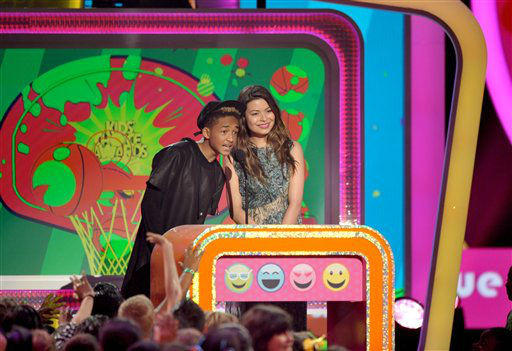 Jaden Smith, left, and Miranda Cosgrove present the award for favorite voice in an animated movie at the 26th annual Nickelodeon&#39;s Kids&#39; Choice Awards on Saturday, March 23, 2013, in Los Angeles. &#40;Photo by John Shearer&#47;Invision&#47;AP&#41; <span class=meta>(Photo&#47;John Shearer)</span>