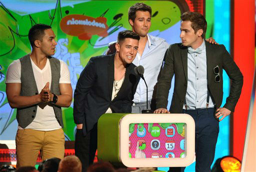 "<div class=""meta ""><span class=""caption-text "">Carlos Pena, from left, Logan Hendewrson, James Maslow, and Kendall Schmidt of the band Big Time Rush speak onstage at the 26th annual Nickelodeon's Kids' Choice Awards on Saturday, March 23, 2013, in Los Angeles.   (Photo/John Shearer)</span></div>"