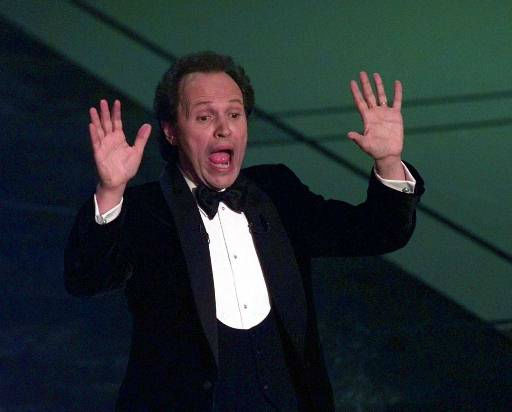 "<div class=""meta image-caption""><div class=""origin-logo origin-image ""><span></span></div><span class=""caption-text"">Billy Crystal reacts during his opening monologue at the 69th annual Academy Awards in Los Angeles Monday, March 24, 1997. (AP Photo/Susan Sterner) (AP Photo/ SUSAN STERNER)</span></div>"