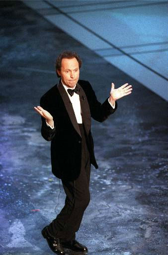 Comedian Billy Crystal goes through part of his routine Monday night, March 24, 1997 as he hosts the Oscar&#39;s at the Shrine Auditorium in Los Angeles. &#40;AP Photo&#47;Long Photo&#41; <span class=meta>(AP Photo&#47; Anonymous)</span>