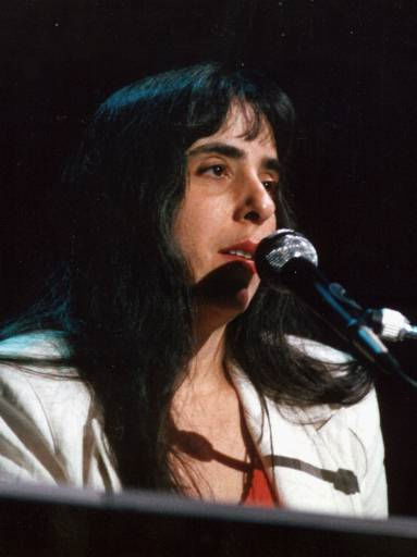 "<div class=""meta ""><span class=""caption-text "">FILE--Laura Nyro is seen in this file photo from June 24, 1988, performing a song in Northhampton, Mass. Nyro, a singer-songwriter, who influenced a generation of women artists with songs like ``Eli's Coming'' and ``Stoned Soul Picnic'' and her intimate blend of pop, folk and jazz, has died at age 49, Tuesday, April 8, 1997, at her home in Danbury, Conn., of ovarian cancer.  (AP Photo/ ROLAND OTERO)</span></div>"