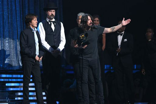 Paul McCartney, from left, Krist Novoselic and Pat Smear, partially obscured, listen as Dave Grohl, foreground, accepts the award for best rock song for ?Cut Me Some Slack&#34; at the 56th annual Grammy Awards at Staples Center on Sunday, Jan. 26, 2014, in Los Angeles. &#40;Photo by Matt Sayles&#47;Invision&#47;AP&#41; <span class=meta>(Photo&#47;Matt Sayles)</span>