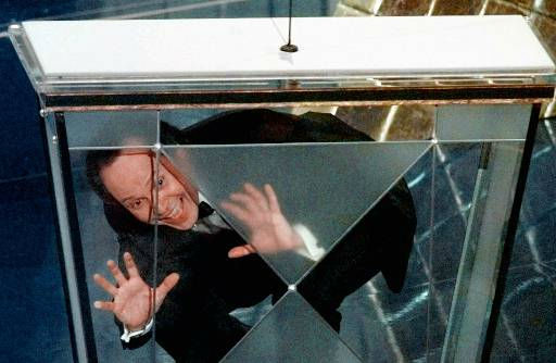 Host Billy Crystal jokes around through the podium  at the 70th Academy Awards in Los Angeles Monday, March 23, 1998. &#40;AP Photo&#47;Susan Sterner&#41; <span class=meta>(AP Photo&#47; SUSAN STERNER)</span>