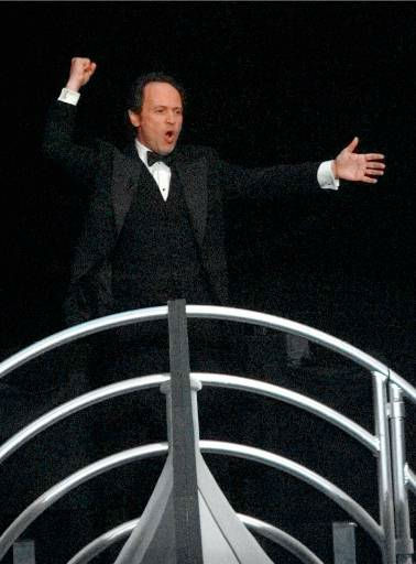 "<div class=""meta ""><span class=""caption-text "">Billy Crystal opens the show on a mock-up of the Titanic  at the 70th Academy Awards in Los Angeles Monday, March 23, 1998. (AP Photo/Susan Sterner) (AP Photo/ SUSAN STERNER)</span></div>"