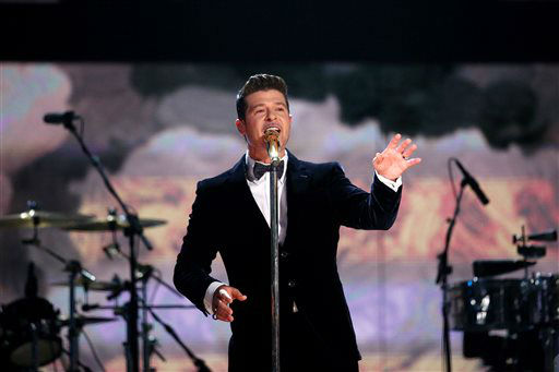 "<div class=""meta image-caption""><div class=""origin-logo origin-image ""><span></span></div><span class=""caption-text"">Robin Thicke performs a medley on stage at the 56th annual Grammy Awards at Staples Center on Sunday, Jan. 26, 2014, in Los Angeles. (Photo by Matt Sayles/Invision/AP) (Photo/Matt Sayles)</span></div>"