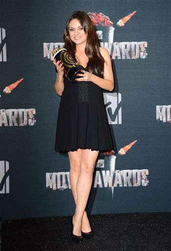 Mila Kunis poses in the press room with her award for best villain for ?Oz the Great and Powerful? at the MTV Movie Awards on Sunday, April 13, 2014, at Nokia Theatre in Los Angeles. &#40;Photo by Jordan Strauss&#47;Invision&#47;AP&#41; <span class=meta>(Photo&#47;Jordan Strauss)</span>