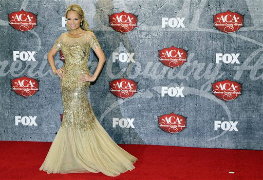 "<div class=""meta ""><span class=""caption-text "">Singer/actress Kristin Chenoweth poses in the press room backstage at the American Country Awards on Monday, Dec. 10, 2012, in Las Vegas. (Photo by Jeff Bottari/Invision/AP) (Photo/Jeff Bottari)</span></div>"
