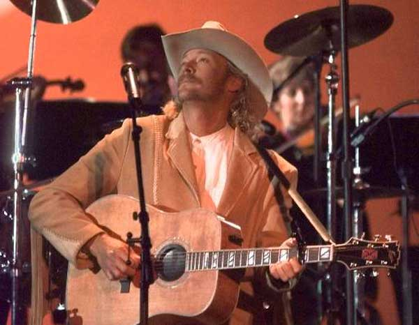 "Alan Jackson performs at the Country Music Association awards show in Nashville, Tenn. Sept. 23, 1998. Jackson, who rose to popularity mostly on easygoing hits like ""Chattahoochee"" and ""Don't Rock the Jukebox,"" sings about separation from wife Denise and the heartache it caused on his new CD, ""High Mileage.""(AP Photo/Michael S. Green)"