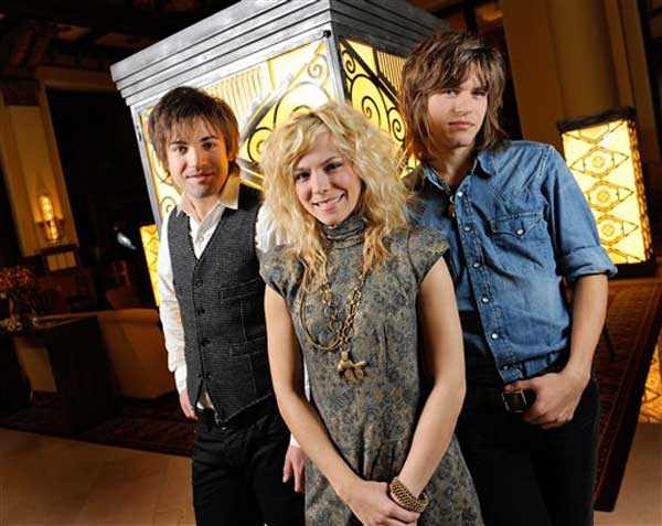 Neil Perry, left, Kimberly Perry and Reid Perry, right, of The Band Perry, pose Tuesday, Nov. 9, 2010, in Nashville, Tenn. (AP Photo/Donn Jones)