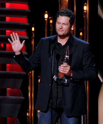 Blake Shelton accepts the Male Vocalist of the Year award onstage at The 47th Annual CMA Awards, on Wednesday, November 6, 2013 at Bridgestone Arena in Nashville, Tenn.  Blake Shelton performs at Rodeo Houston on Thursday, March 20, 2014. &#40;Photo by Frank Micelotta&#47;Invision&#47;AP Images&#41; <span class=meta>(AP Photo)</span>
