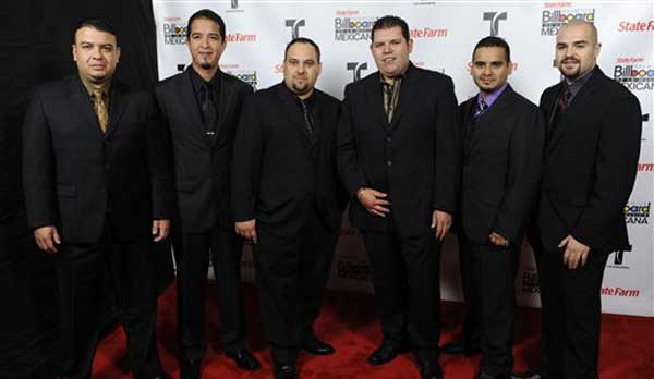 Duelo poses backstage at the first annual Mexican Billboard Awards on Thursday, Oct. 20, 2011, in Los Angeles. (AP Photo/Chris Pizzello)